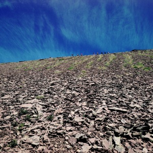 Looking up the scree to people walking the ridge