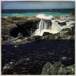 Thor's Well fills and empties as the tide comes in.