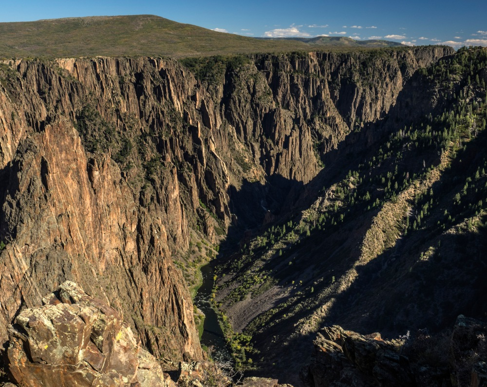 The Gunnison River cuts deep into the canyon.